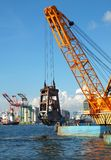 Dredger lifts Mud from Harbor Berth Stock Photos