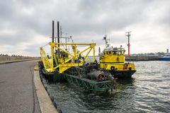 Dredger moored at the wharf in the harbor Royalty Free Stock Images