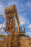Dredger moving ground with blue sky Stock Image