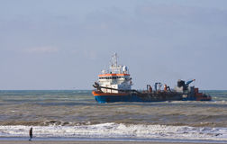 Dredger Ready for Rainbowing. A Trailing suction hopper Dredger at Work on the dutch coast royalty free stock photos
