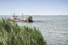 Dredger on the river Royalty Free Stock Images