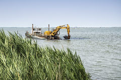 Dredger on the river Stock Image