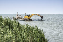 Dredger on the river Stock Images
