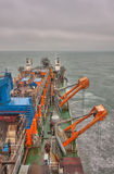 Dredger at sea. A trailing suction hopper dredger at sea dredging royalty free stock images