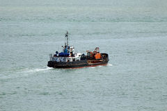 Dredger at sea. A dredger working at sea Stock Image