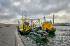 Dredger ship navy working to clean a navigation channel Royalty Free Stock Photo
