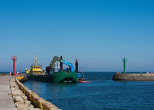 Dredger ship in port. Or harbor entrance Stock Photos
