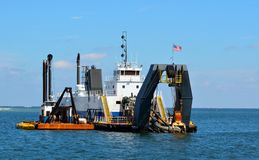 Dredger ship working in ocean Royalty Free Stock Photos