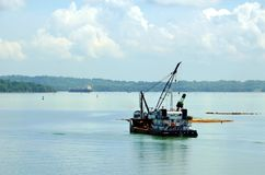 Dredger ship working on the Panama Canal waters. royalty free stock photography