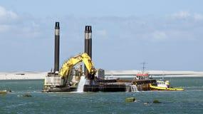 Dredger ship working at sea Stock Photos