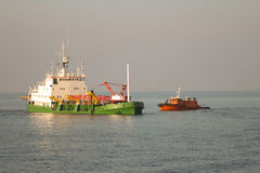 Free Dredger Vessel And Pilot Boat Mooring In Open Sea Stock Photo - 82987900