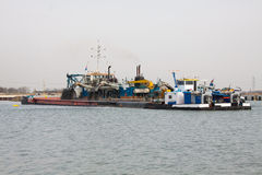 A  dredger at work Stock Photos