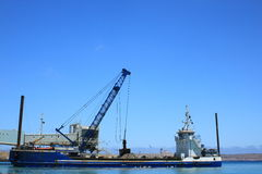 Dredger at work stock photography