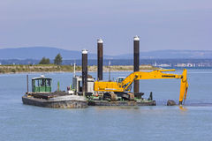 Dredger is working, near Bregenz, Austria Stock Photo