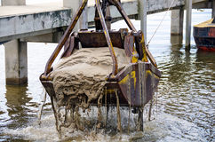 Dredging bucket in lake marina Stock Photo