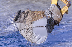 Dredging with an excavator Royalty Free Stock Photo