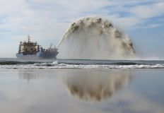 Dredging off the Queensland coast. Stock Photos