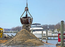 dredging out a marina boat slip Royalty Free Stock Photos