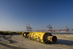 Dredging pipe. A dredging pipe in Rotterdam harbor stock photo