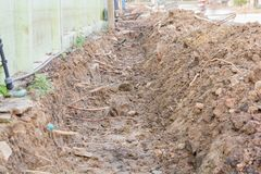 Dredging, soil to repair the drain,. In the village royalty free stock photography
