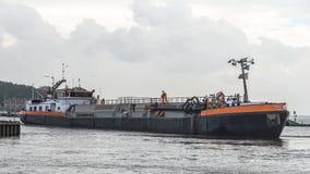 Dredging Vessel Entering the Harbor Stock Photos