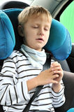 Dreem in car. Young boy sleeping in the carseat Stock Image