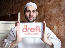 Dreft laundry detergent brand logo. Logo of Dreft brand on samsung tablet holded by arab muslim man. Dreft is a laundry detergent in the United States, Canada royalty free stock photos