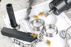 Drehbankhilfsmittel, -bohrgerät und -werkstück stockbilder