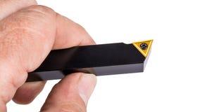 Drehbankschneider mit gelbem Dreieckeinsatz von gesintertem Karbid lizenzfreie stockfotografie