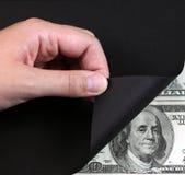 Drehen Sie schwarze Seite und Geld Lizenzfreies Stockfoto