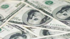 Drehendes Geld in den großen Bezeichnungen Dollar Vereinigter Staaten stock video