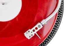 Drehscheibennadel auf einer roten Platte Lizenzfreie Stockbilder