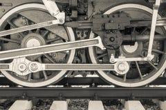 Dreht alte Lokomotive der Nahaufnahme der beige Farbe Stockfoto