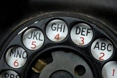 Drehvorwahlknopf am alten Telefon Stockfotografie