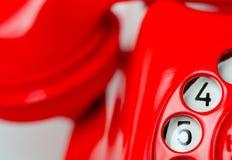Drehvorwahlknopf des roten Telefons Lizenzfreie Stockfotografie