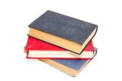 Drei alte Bücher auf einem weißen Hintergrund Stockfotografie