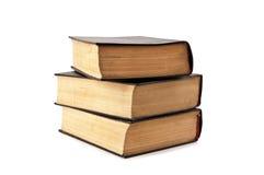 Drei alte Bücher kosteten einen Stapel Lizenzfreie Stockfotos