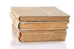 Drei alte Bücher zusammen gestapelt Lizenzfreies Stockbild