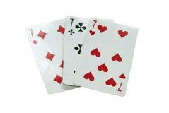 Drei alte Spielkarten, drei sieben. stockbild