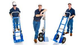 Drei Anlieferungs-Kerle mit Transportwagen lizenzfreies stockfoto