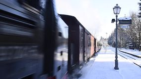 Drei Annen Hohe Station with steam Locomotive. Drei Annen Hohe, Germany - February 5, 2018: Steam locomotive of the Harzer Schmallspurbahnen in wintertime coming stock video footage