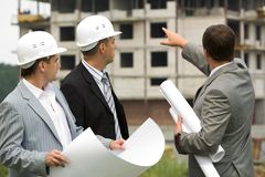 Drei Arbeitskräfte stockfoto