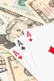 Drei Asse auf Dollarbanknote Lizenzfreie Stockfotos