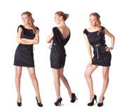 Drei attraktive junge Frauen in einem schwarzen Kleid Lizenzfreies Stockbild