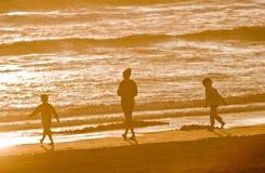 Drei auf dem Strand lizenzfreies stockbild