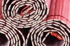 Drei aufgerollte Bambusmatten Stockfotografie