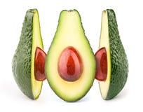 Drei Avocados mit den öligen Steinen lokalisiert Lizenzfreies Stockfoto