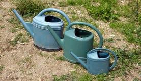Drei Bewässerungsdosen Lizenzfreie Stockfotos