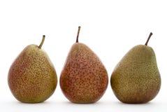 Drei Birnen auf Weiß Lizenzfreies Stockfoto