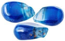 Drei Blau-getonte Achatedelsteine lokalisiert Stockbilder